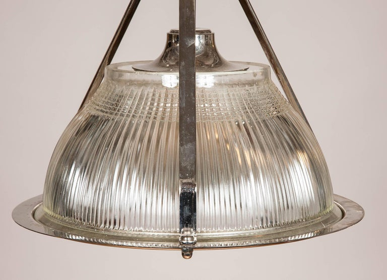 1960s nickel-plated hanging lights formerly used to light aircraft hangers made by Holophane.  Rewired for domestic electricity.  Holophane is a manufacturer of lighting-related products founded in 1898 in London, England. The hallmark of