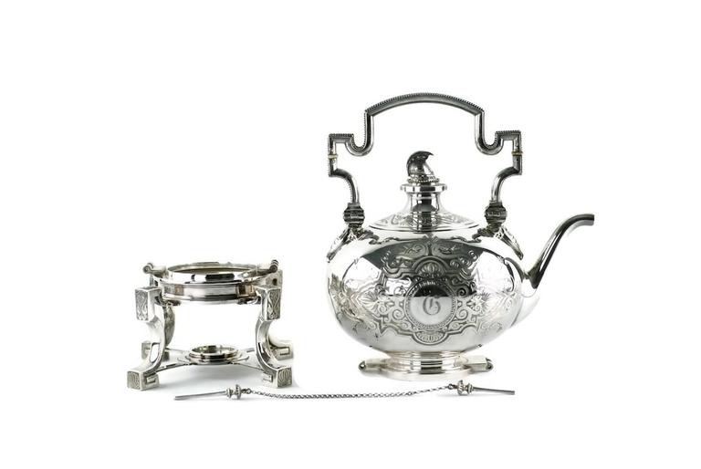 This neoclassical sterling silver tea and coffee set was designed by renowned 19th century silversmith, John R. Wendt (1826-1907). Recognized as