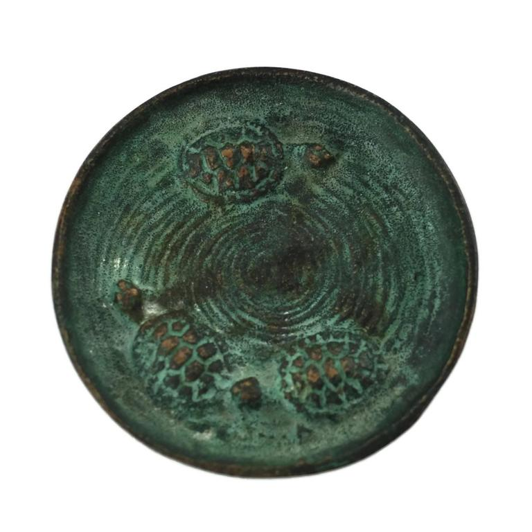 This bronze dish was made by multitalented artist and sculptor Edward Timothy Hurley (1869-1950). E.T. Hurley studied at the Art Academy of Cincinnati where he excelled in drypoint etching under the tutelage of noted painter Frank Duveneck. Hurley