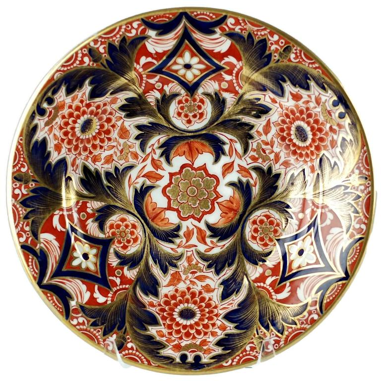 These English porcelain plates are decorated in an ornate Imari pattern and were made by Derby at their Nottingham Road factory, which was in operation from 1756-1848. The manufactory was granted the right by George II to use the crown as part of