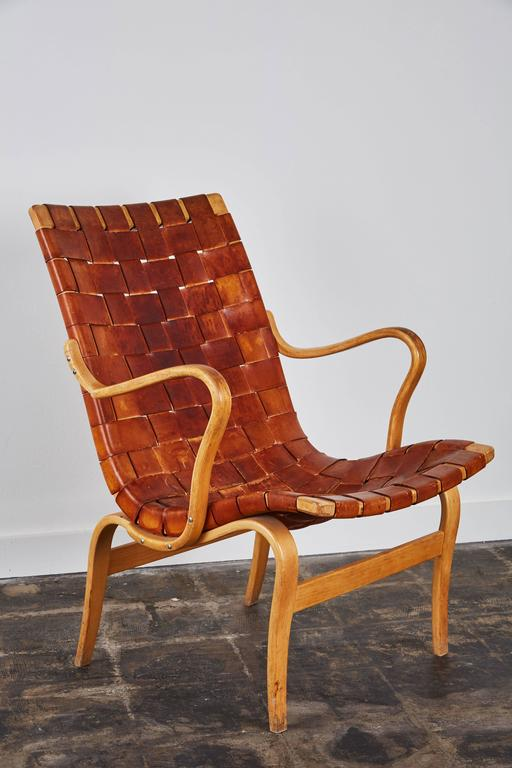 Pair of patinated leather armchairs by Bruno Mathsson for Karl Mathsson. Made in Sweden, circa 1960s.