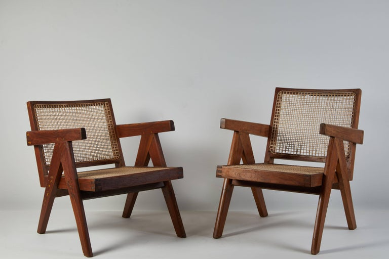 Cane and teak Easy Armchairs by Pierre Jeanneret for Punjab University in Chandigarh. Made in India/France circa 1956.  Available with cushion.