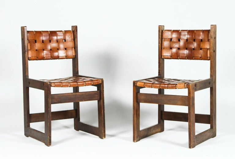 Rare pair of woven leather chairs made in Belgium, circa 1950s.