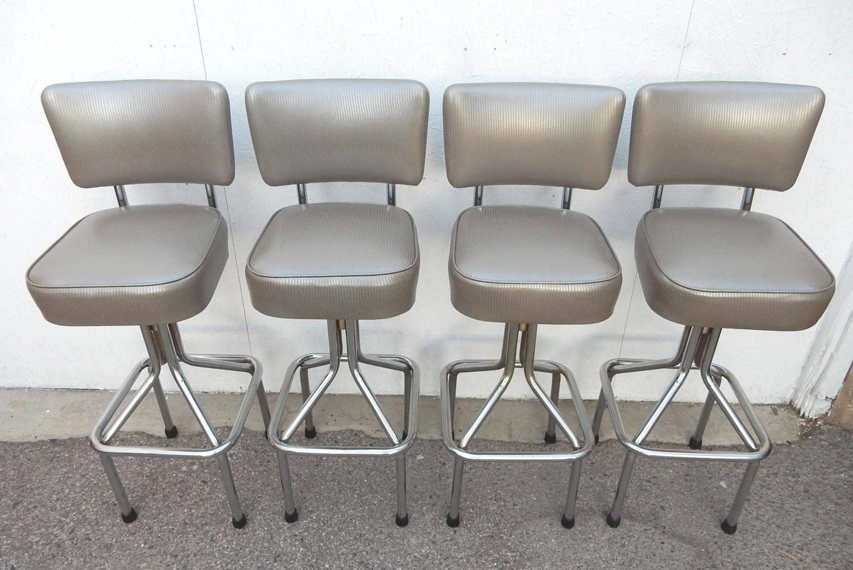 Mid century modern 1950s chrome tall swivel bar stools in faux