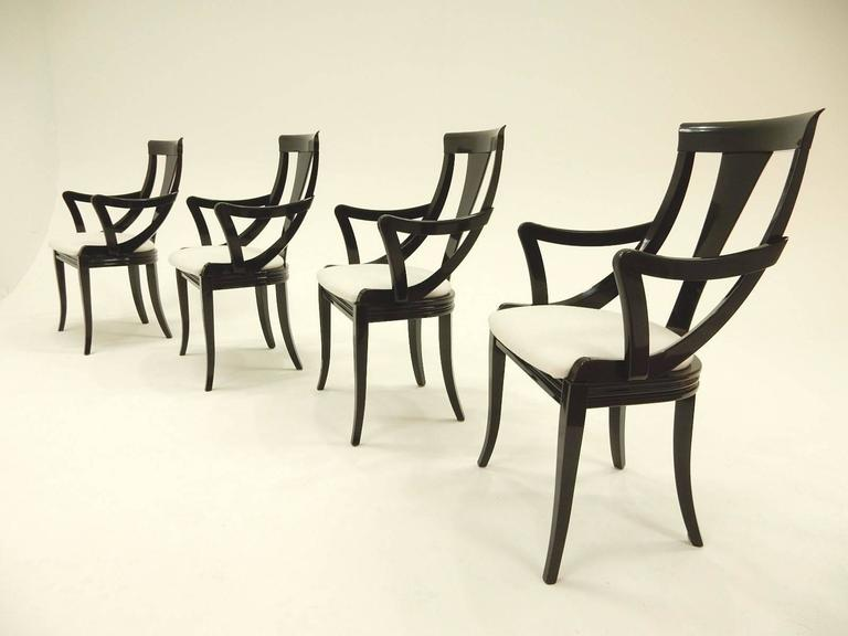 Sculptural armchairs by designer Pietro Costantini in glossy black lacquer. Distributed by Ello Furniture, circa 1970s. Chairs are new upholstered in woven white wool. Each has Pietro Costantini tag on back of cushion. All are solid with no