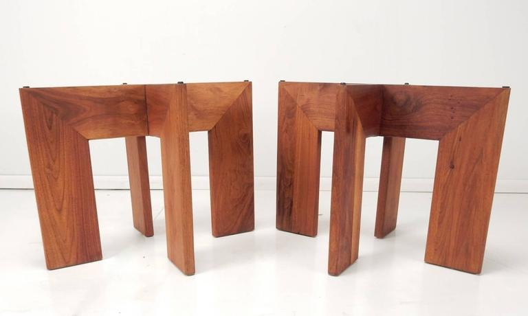 Mid-Century Modern side tables designed by Adrian Pearsall. Pair, with thick black natural stone slate tops on four large flat walnut legs.