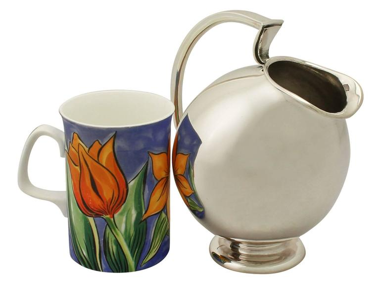 An exceptional, fine and impressive vintage continental sterling silver water jug made in the Design style; part of our dining silverware collection.  This exceptional vintage European sterling silver water jug has a ovoid rounded form onto a
