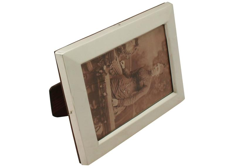 A fine and impressive antique Victorian English sterling silver photograph frame; an addition to our ornamental silverware collection