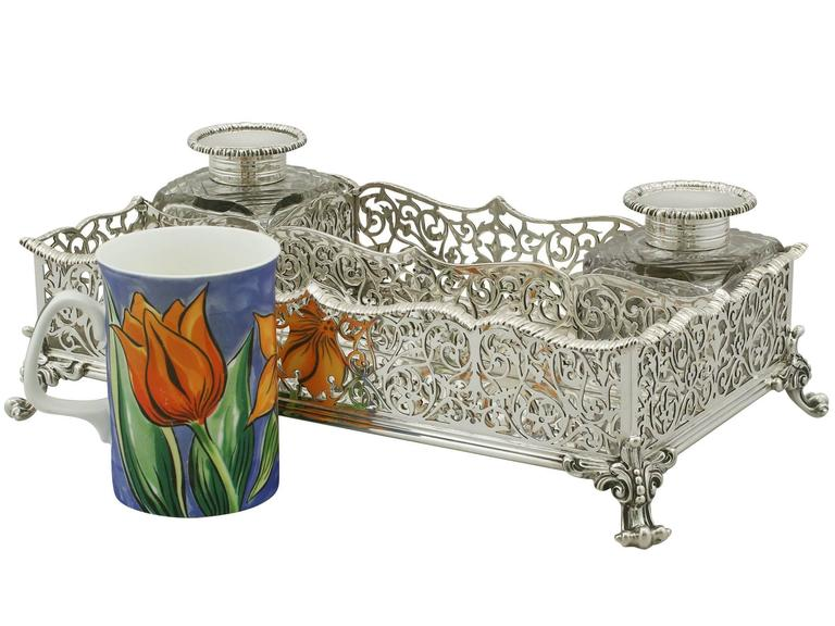 An exceptional, fine and impressive antique Victorian English sterling silver gallery inkstand; an addition to our ornamental office silverware collection  This exceptional antique Edwardian sterling silver large silver desk standish has a