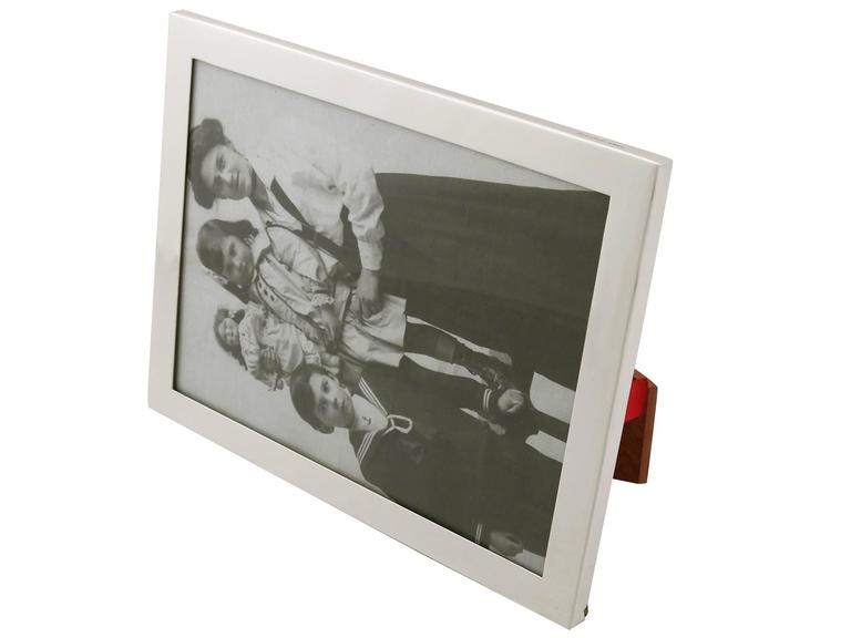 An exceptional, fine and impressive vintage Elizabeth II English sterling silver photograph frame, retailed by Asprey; an addition to our ornamental silverware collection  This exceptional vintage Elizabeth II sterling silver photo frame has a