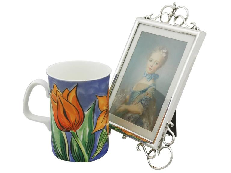 An exceptional, fine and impressive antique Edwardian English sterling silver photograph frame; an addition to our ornamental silverware collection  This fine antique Edwardian sterling silver photo frame has a plain rectangular rounded form with