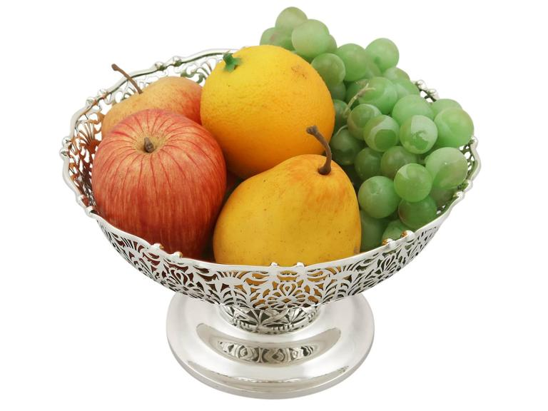 An exceptional, fine and impressive antique George V English sterling silver centrepiece / fruit bowl; an addition to our ornamental silverware collection  This exceptional antique sterling silver fruit bowl has a circular rounded form onto a