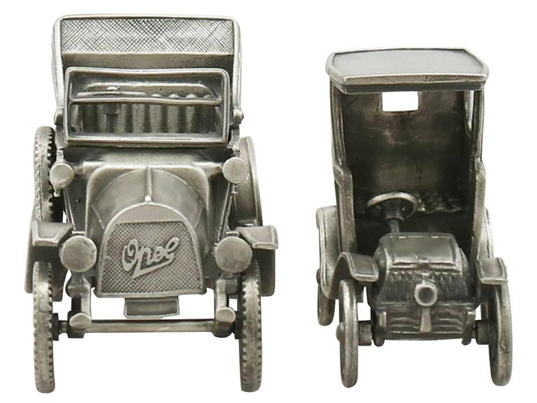 These impressive vintage Italian cast sterling silver table ornaments have been realistically modelled in the form of two early 20th century automobiles.  The first piece reflects the style of an Opel Cottereau and the second can be associated