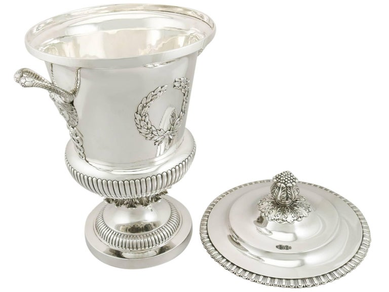 A magnificent, fine and impressive, large antique Edwardian English sterling silver cup & cover; an addition to our antique presentation silverware collection.  This magnificent and large antique Edwardian sterling silver presentation cup and