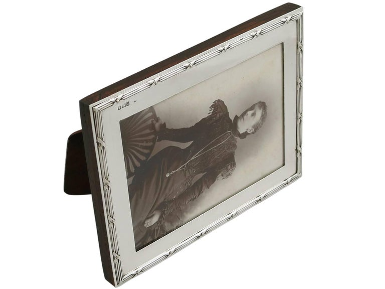 An exceptional, fine and impressive antique Edwardian English sterling silver photograph frame made by William Comyns & Sons; an addition to AC Silver's ornamental silverware collection.