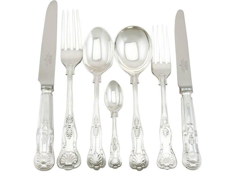 An exceptional, fine and impressive antique George V English sterling silver straight King's pattern flatware service for twelve persons; an addition to AC Silver's canteen of cutlery collection  The pieces of this fine, antique George V sterling