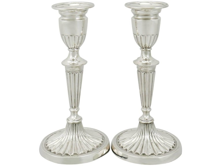 An exceptional, fine and impressive pair of antique Edwardian English sterling silver piano candlesticks in the Adams style; an addition to our ornamental silverware collection  These exceptional antique Edwardian sterling silver piano