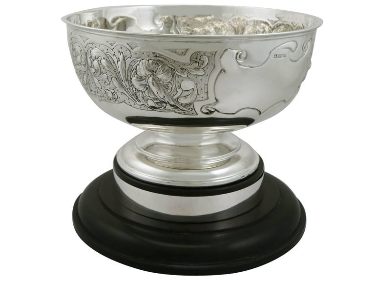 An exceptional, fine and impressive antique Edwardian English sterling silver presentation bowl; an addition to our ornamental silverware collection.