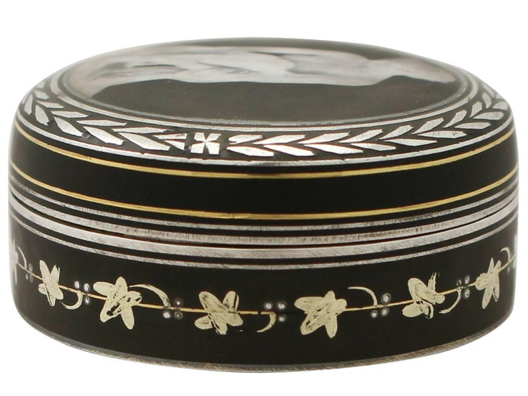 A fine antique continental sterling silver and transfer printed box; part of our continental silverware collection  This antique continental sterling silver and transfer printed box has a cylindrical form.  The body is encircled with inlaid gold