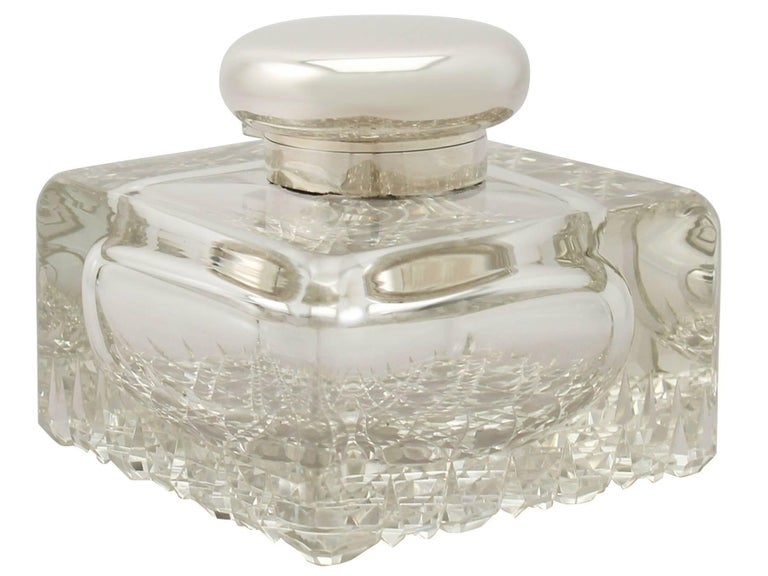 An exceptional, fine and impressive, large antique George V cut-glass and English sterling silver mounted desk inkwell made by Asprey & Co; part of our antique silver and glassware collection.  This fine antique George V cut glass and English