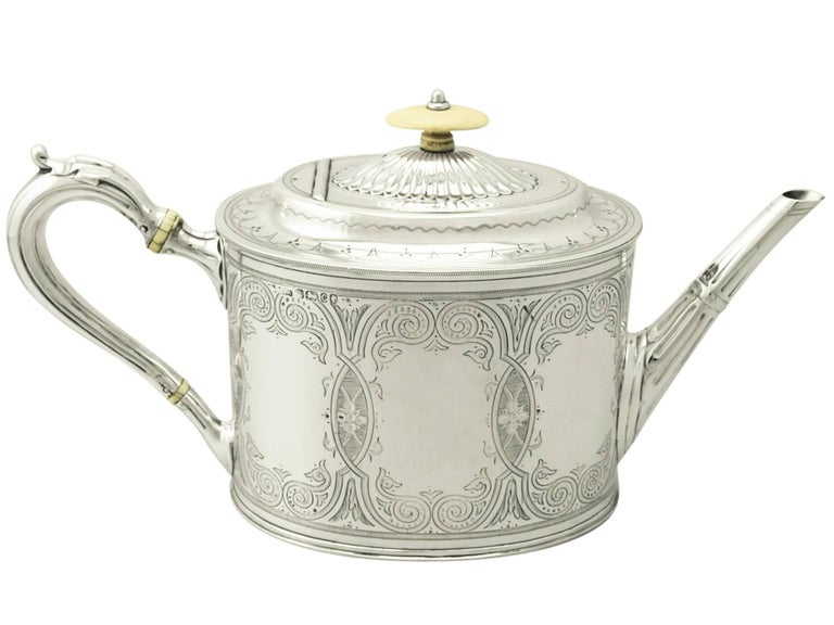 A fine and impressive antique Victorian English sterling silver four-piece tea and coffee service; an addition to our silver teaware collection.