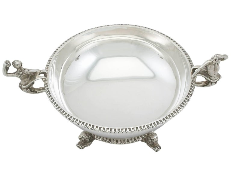 A fine and impressive antique Victorian English sterling silver sugar/bon bon bowl; an addition to our dining silverware collection  This fine antique Victorian sterling silver bon bon/sugar bowl has a plain circular rounded form.  The surface