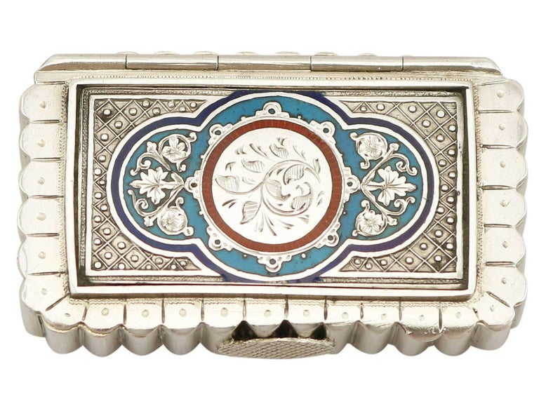 An exceptional, fine and impressive, unusual antique Victorian English sterling silver and enamel vesta box; an addition to our silver boxes collection.  This exceptional and unusual antique Victorian sterling silver vesta box has a rectangular,