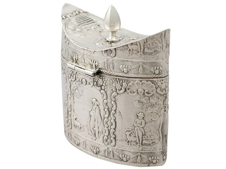 A fine antique Dutch silver tea caddy; an addition to our silver teaware collection.  This fine Dutch silver tea caddy has a navette shaped oval form.  The surface of this antique silver tea caddy is embellished with embossed panels depicting