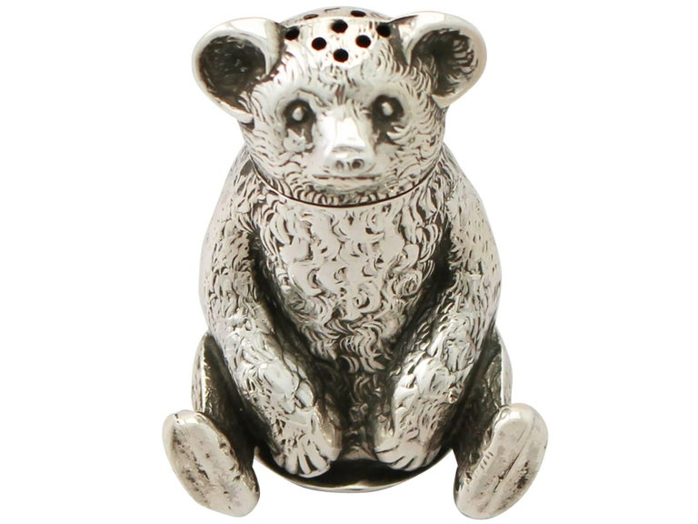 A fine and impressive antique Edwardian English sterling silver pepper shaker realistically modelled in the form of a bear; an addition to our range of silver novelty items