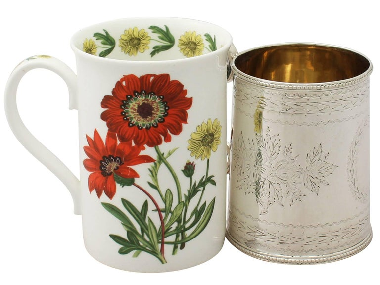 A fine and impressive antique Victorian English sterling silver christening mug; an addition to our range of silver christening gifts.  This impressive antique Victorian sterling silver christening mug has a subtly tapering cylindrical