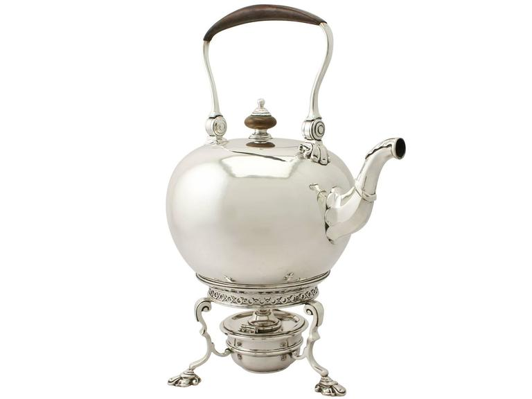 An exceptional, fine and impressive antique Edward VIII English sterling silver spirit kettle made in the George I style; an addition to our silver teaware collection  This exceptional antique Edward VIII sterling silver spirit kettle has a plain