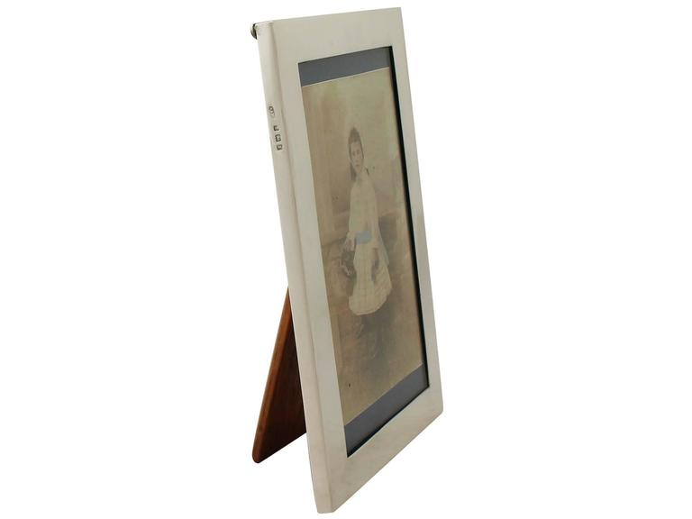 A fine and impressive antique George V English sterling silver photograph frame an addition to our collection of ornamental silverware.