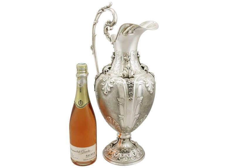 An exceptional, fine and impressive, large vintage Italian silver wine ewer and presentation plate, part of our wine and drinks related silverware collection.  This exceptional and large antique Italian silver ewer has a rounded ovoid shaped form