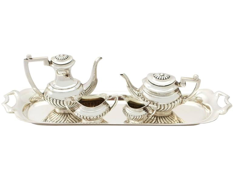 An exceptional, fine and impressive vintage Elizabeth II English sterling silver miniature Queen Anne style four piece tea & coffee service with a matching tray - boxed; part of our silverware collection  The exceptional vintage Elizabeth II