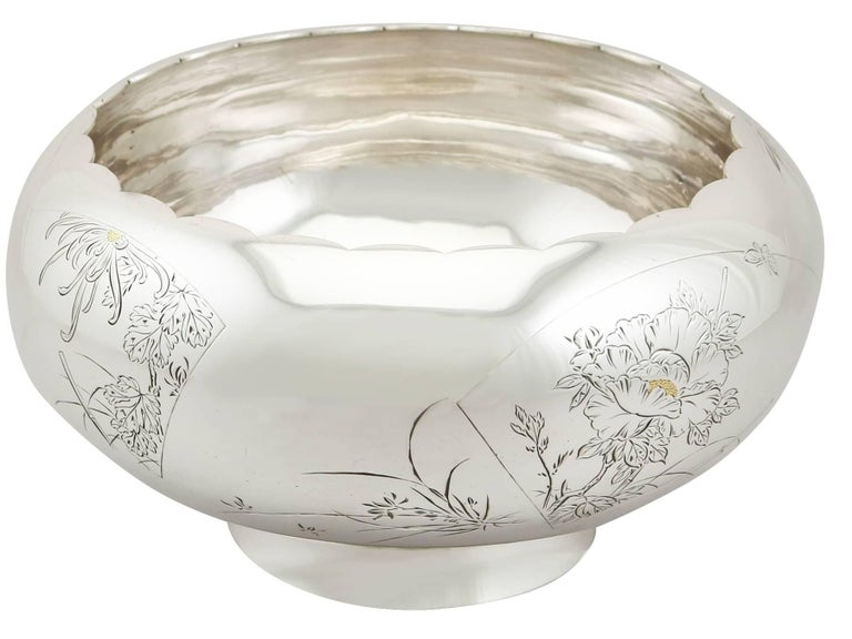 An exceptional, fine and impressive antique Japanese silver presentation bowl; part of our Asian silverware collection.  This exceptional antique Japanese silver bowl has a circular rounded form onto a plain tapering circular collet foot.  The