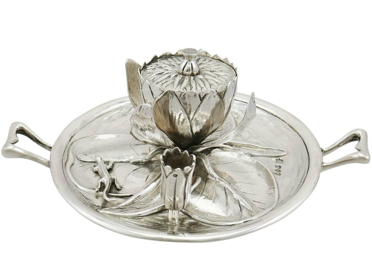 An exceptional, fine unusual and impressive antique Victorian English sterling silver inkwell in the form of a water lily; an addition to our ornamental silverware collection.  This exceptional antique Victorian cast sterling silver inkwell has been