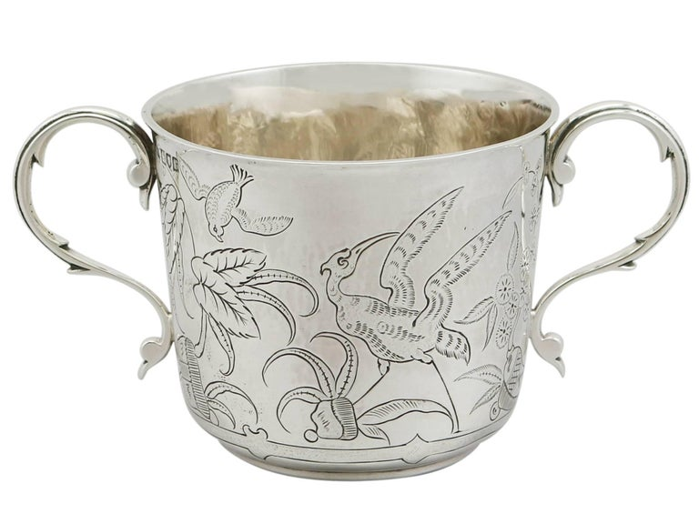 An exceptional, fine and impressive antique George V English sterling silver porringer made by Lambert & Co; part of the AC Silver collectable silverware collection.  This exceptional antique George V sterling silver porringer has a plain inverted