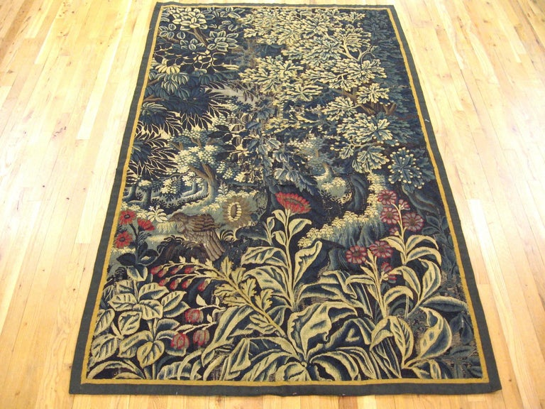 Antique 17th Century Verdure Landscape Tapestry with a Large Tree and Flowers In Excellent Condition For Sale In New York, NY