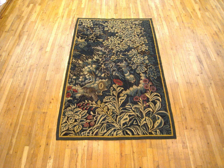 This tapestry is a Franco-Flemish verdure landscape tapestry from the late 17th century, circa 1690. It is a fragment, having lost its original borders, with supplemental borders having been added at a later date. This tapestry may have been