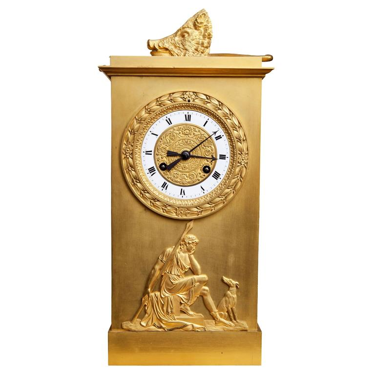 France, circa 1820-1830.  A large-scale early 19th century bronze and gilt bronze mantel clock, the clocks hunting theme, featuring three different scenes. The bronze Diana deer stalking; her bow, arrow, horn and a boar's head show what has been