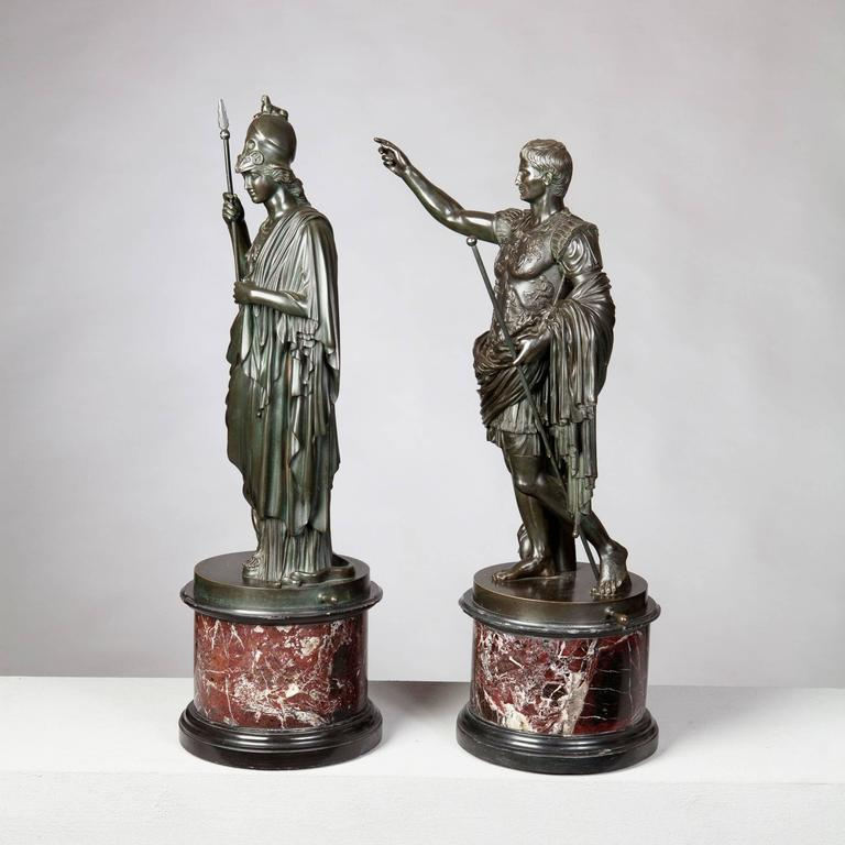 A pair of fine 19th-century bronze statues of Minerva and the Roman Emperor Augustus, both finely cast and patinated with a slight green tone. Both raised on their original rouge marble bases. 