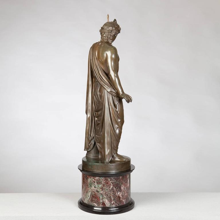 A bronze statue of a Roman classical figure holding a later sceptre by Boschetti, 19th century on a marble pedestal impressed BOSCHETTI / ROMA.  Measures: Height including base: 38in. Diameter: 11in.  Benedetto Boschetti was an Italian