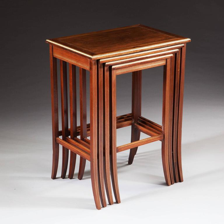 Nest Of Four Antique Mahogany And Brass Inlaid Tables For