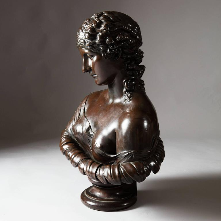 Northern Europe, 19th Century.   A large electrotype patinated bronze on copper sculptural bust of Clytie raised on integral socle.  Measures: Height 29 inches.   Clytie was a name given to a number of figures in Greek mythology. However, the