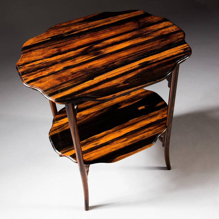 A very unusual Indian export 19th century calamander wood table the scalloped shaped top supported on a folding Stand with legs of Chinese design. The lower level also removable.   This table was almost certainly made in India for the Asian