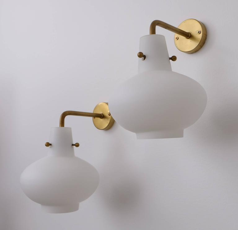 Very rare model. Produced by Ateljé Lyktan, Åhus, Sweden. Designed by Hans Bergström. Brass and opaline glass.