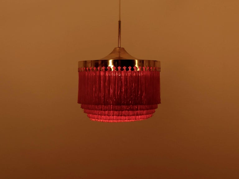 Orange fringes and patinated brass.