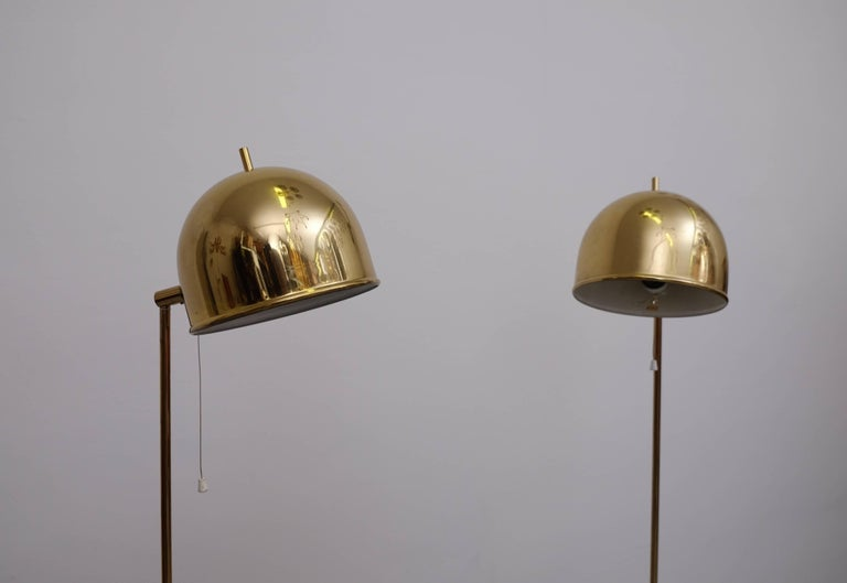 Set of two floor lamps in brass, model G-075 manufactured by Bergboms, Sweden, 1960s.