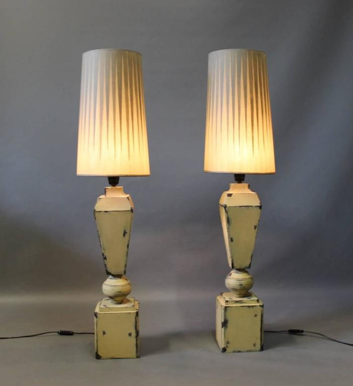 Tall tablelamps of painted metal with grey lamp shades of an unknown designer. The lamps are from around the 1960s.