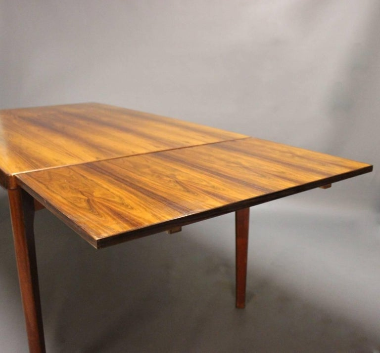 Scandinavian Modern Dining Table in Teak with Extensions by Henning Kjærnulf, 1960s For Sale